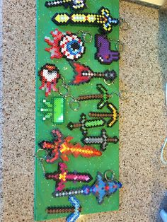 Terraria party favor.  Perler bead favors.  Each child received a green box with a secret card inside that matched up with a keychain. Huge hit.