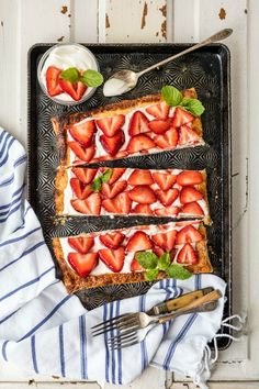 This Puff Pastry Strawberry Tart comes together in 10 minutes! Serve it up with a scoop of vanilla ice cream for the perfect summer dessert.