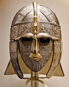 The Sutton Hoo helmet is a decorated and ornate Anglo-Saxon helmet found during a 1939 excavation of the Sutton Hoo ship-burial. It was buried around 625 and is widely believed to have belonged to King Rædwald of East Anglia Saxon Chronicles, Anglo Saxon Chronicle, Anglo Saxon Kingdoms, Anglo Saxon History, Suffolk Coast, Sutton Hoo, Medieval, Netflix, Primitives