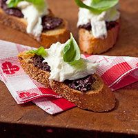 Olive & Burrata Crostini    Salty olives and creamy burrata cheese make the perfect Italian appetizer.