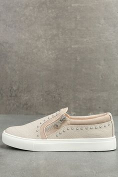"Take a walk on the wild side in the Report Andre Cream Leather Studded Slip-On Sneakers! Cream snake print embossed vegan leather shapes these cool slip-on sneakers, with silver studs and side zippers. 1"" white bumper sole."