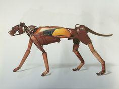 Guepardo 140 x 70 x 30 cm. Realizado con un deposito de Ducati, hierros de tractor, bobinas de hilatura, una pata de bañera, y diferentes piezas recicladas. Escultura de Miquel Aparici