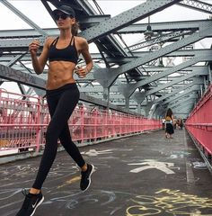Ultra fit Victoria Secret angel Izabel Goulart taking on the Williamsburg Bridge in her Montiel teardrop bra and Lea Legging.