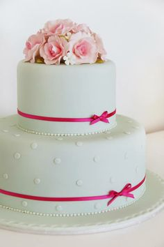 So simple...love the small ribbon around cake. would just do different colors