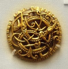 9-11c Anglo-Viking style brooch of gilded bronze in Urnes style British Museum
