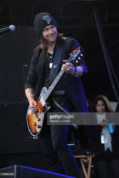 Myles Kennedy of Alter Bridge performs during the 2014 Louder Than Life Festival at Champions Park on October 4, 2014 in Louisville, Kentucky.