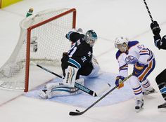 San Jose Sharks goaltender Antti Niemi prepares to make a save against Edmonton Oilers forward David Perron (Dec. 18, 2014).