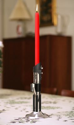 Solid metal candlestick is a perfect re-creation of Darth Vader's lightsaber; Comes with three no-drip red taper candles; Accepts standard taper candles for replacements; Base unscrews for more movie accurate look.$29.99    Star Wars Lightsaber Candlestick