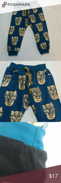 NWOT Gold Blue Tiger Sweatpants Adorable and very warm and trendy harem pants in blue / teal with gold tiger design.  Inside is double lined,  warm and comfortable  This item is brand new and never used Bottoms Sweatpants & Joggers