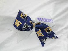 This is not a licensed University of Washington product. It is however, hand crafted from licensed University of Washington fabric. I am not affiliated with or sponsored by University of Washington. This bow measures 9.5 inches wide and 6 inches tall with a ribbon width of 3 inches.