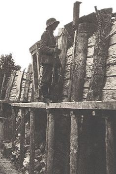 German soldier on sentry duty in a well-constructed trench on the Somme battlefield, 1916.