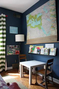 scroll map, horizontal striped curtains, vintage toys and book displays. I'd do with navy/white curtains, lighter walls or panelled boards, a little grey and natural wood. Love the vintage map