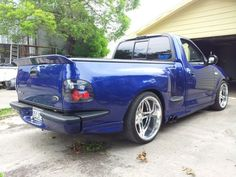 Ford svt lightning , with wide tires and a wing.