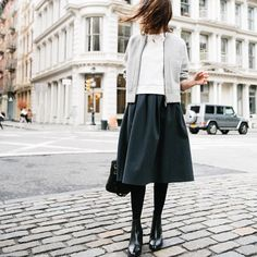 Love the vintage feel to this modern look. She looks so Parisian!