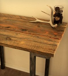 Reclaimed Wood Bar Table.  This gives me an idea for our basement living area