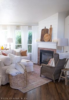 A cozy, rustic family room decorated for fall with touches of plaid, vintage amber glass, wood tones, and other antique elements,elements, enhanced with so much texture through blankets, throws and pillows. Cozy Family Rooms, Family Room Decorating, Family Room Design, Decor Interior Design, Interior Decorating, Fall Decorating, Amber Glass Jars, Custom Drapes, Fall Family