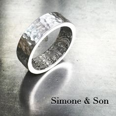 Our LoveMark customization really adds a unique element to this men's wedding band. #simoneandson #customring #mensjewelry #lovemark #fingerprintjewelry #orangecounty