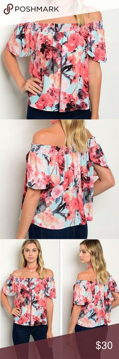 Aqua Coral Floral Off Shoulder Top You will fall in love with this print! Coral pink roses pop off of a green-blue aqua background. Great piece for laying with cardigans and blazers. Loose fit. Flutter sleeves. Elastic banded neckline can be worn on or off shoulder. 100% Polyester. Lavender Moon Tops