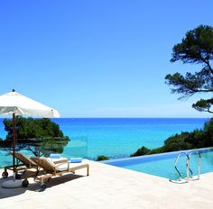 Hotel Can Simoneta | Boutique Hotel | Spain | http://lifestylehotels.net/en/can-simoneta | outdoor, view, pool, sea, lounger, sun, summer