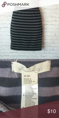 "Forever 21 mini skirt Super cute striped black and grey mini skirt. Stretchy and clingy it would look great over a pair of leggings with boots. Size Medium. In great condition.   Measurements :: Waist 26"" - Hips 30""- Length 17"" Forever 21 Skirts Mini"