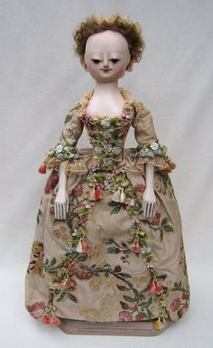 """16.5"""" Flora is based on an antique example from the 1735 / 1740 era. Her dress is 18th century fabric and is trimmed with """"rare as hen's teeth"""" 18th-century fly-braid."""