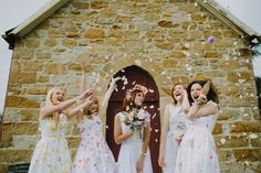 Dress your bridesmaids in mismatched floral gowns for a whimsical spring wedding look.