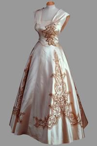 Cream silk gown with embroidery in gold and pearls    Norman Hartnell    Worn by Princess Elizabeth for official portraits taken at Clarence House by Yousuf Karsh prior to the Tour of Canada, October 1951. (Queen Elizabeth II)