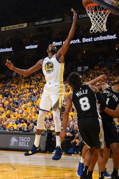 Kevin Durant of the Golden State Warriors goes to the basket against the San Antonio Spurs in Game Five of Round One of the 2018 NBA Playoffs on...