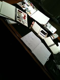 my design books on my desk...with samples of my leather..and materials awaiting me at my factory in LA...