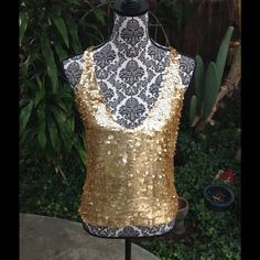 Disc it baby! Beautiful gold top by DKNY. Plunging V neckline. Crisscross back. Neiman Marcus DKNY Tops