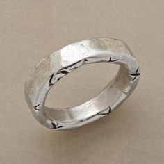 WAVES OF LOVE RING -- Jes MaHarry engraves one edge of her sterling silver ring with an infinite wave, the other with X's for kisses and a loving heart. Exclusive. Handcrafted in USA. Whole sizes 5 to 9.