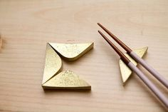 Featuring a crude casting surface and modular in nature, the Futagami Brass chopstick rest changes color over time as the brass oxidizes. Designer Masanori Oji and Futagami, one of Japan's oldest meta