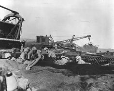Marines,surrounded by military equipment, dig foxholes into the sand on the beaches of Iwo Jima on June D-Day. Once A Marine, My Marine, Marine Corps, Usmc, Marines, Countries Of Asia, Battle Of Iwo Jima, North Platte, Semper Fi