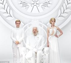 Peeta Mellark (Josh Hutcherson) and Johanna Mason (Jena Malone) stand obediently beside President Snow as he delivers a Panem address called 'Unity' in a white room filled with Peacekeepers (click the picture to view the new teaser!)