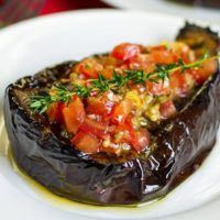 This paleo eggplant recipe is a delicious combination of roasted eggplant boats filled with thyme and tomato salsa. Suitable for vegans and vegetarians.
