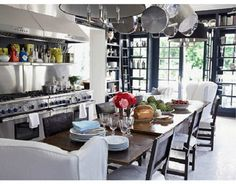Windsor Smith's kitchen. Love the wing chairs!