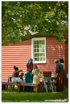 Pioneer women and girls in front of School House at Genesee Country Village