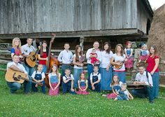 Gil and Kelly Bates family - this setting seems to fit their style - cantilever barn, rail fence, instruments, and the clothing choices.    (Meet the Bates Family: United Bates of America: TLC...too bad there are no plans for more episodes)