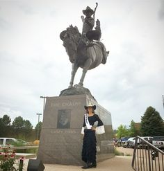 Marrika Nakk skirt and peasant blouse in front of the Casey Tibbs statue at the pro rodeo hall of fame and museum