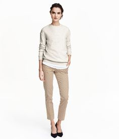 Weiß/Gemustert. Slacks aus stretchiger Baumwollmischung mit Seitentaschen, einer paspelierten Potasche und Häkchenverschluss vorn.