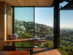 Retractable walls and numerous terraces feature in this expansive California home designed by US architecture firm Olson Kundig. Orange Front Doors, Retractable Door, San Gabriel Mountains, Infinity Edge Pool, Metal Siding, Architectural Services, Design Within Reach, Los Angeles Homes, California Homes