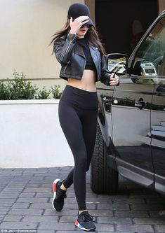 Kendall Jenner wearing Laer Cropped Moto Leather Jacket, Ahlem Eyewear Concorde Sunglasses in Palladium White Gold, Yeezy Season 1 Black Cropped Tank Top, Lululemon Hi-Rise Wunder Under Pants and Adidas Nmd Runner Primeknit Sneakers New York Fashion, Star Fashion, Look Fashion, Teen Fashion, Runway Fashion, Fashion Models, Fashion Outfits, Fashion Trends, Fashion Clothes