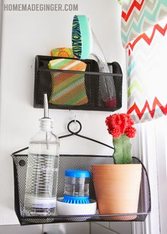 Surplus office organizers are perfect for storing cleaning supplies and small plants, like in blogger Homemade Ginger's sink area.   - HouseBeautiful.com