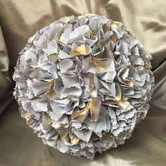 They're not just for flower girls. For a modern twist on the traditional flower ball or pomander, try making yours out of metallic paper.
