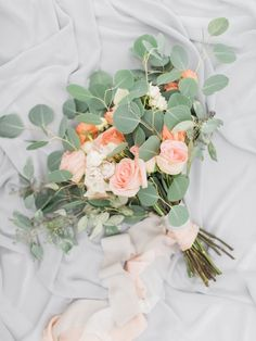 Whimsical peach roses and eucalyptus wedding bouquet