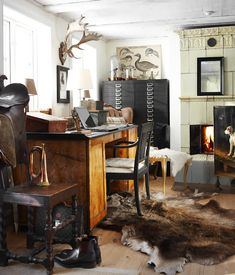 Take some of this bizness out...but liking the fur/animal heads on the wall.  Guess I need to go a huntin'