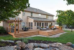 Rustic Transitional Backyard Porch with Wood Log Trellis