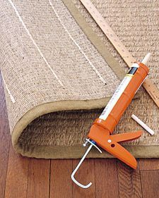 """- """"To give a sisal or sea-grass area rug some traction, flip it over, and apply lines of acrylic-latex caulk every 6 inches or so. Once dry, you can safely put down your rug; the rubbery strips will hold it in place"""" -"""