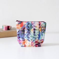 BARGELLO: Geometric triangle pattern, printed linen pouch. Multicoloured rainbow design. Bright, bold, colourful. Green, yellow, pink, grey. by PixelAndThread on Etsy https://www.etsy.com/listing/249129329/bargello-geometric-triangle-pattern