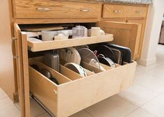 A single-height #PullOutShelf atop a #TrayBin is the perfect #cabinet upgrade to organize your cookie sheets, platters and cutting boards!  http://www.shelfgenie.com/
